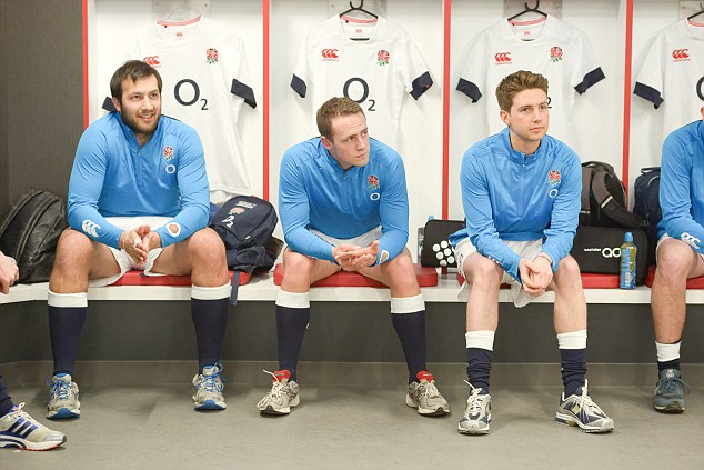 Ready for action: Sportsmail's Nik Simon (left) is given a team talk in the England dressing room