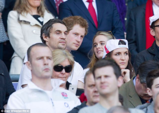 Smiling: The couple chat as they watch the action on the pitch