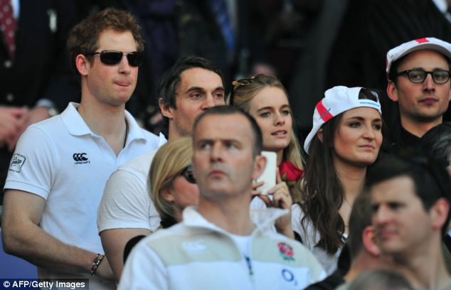 Concentration: Harry and Cressida watch the game among other England fans