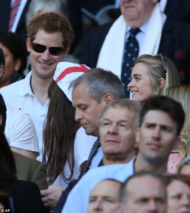 Spotted: Harry grins as a fellow spectator in an England hat twigs the royal in the crowd