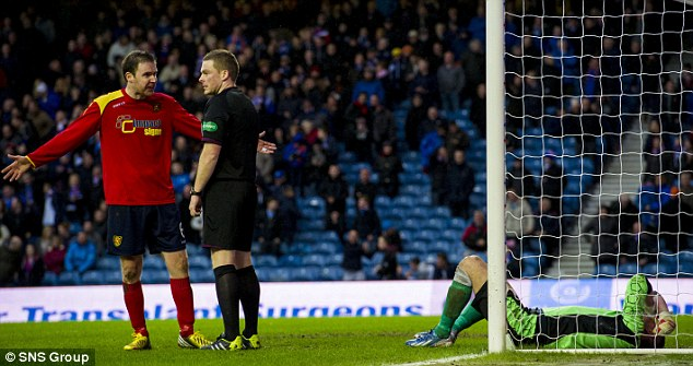 Complaints: Rovers players complain to referee John Beaten as goalkeeper Neil Parry is left on the turf