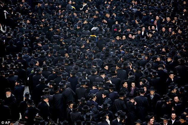 Sea of black: The protestors' traditional garb made for a vivid sea of dark cloth flowing down Manhattan streets