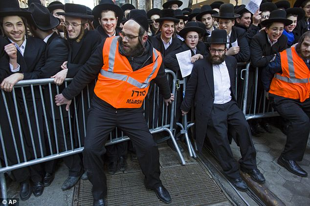 Spilling over: Barricades are secured as thousands of the ultra-Orthodox Jews gathered on Water Street