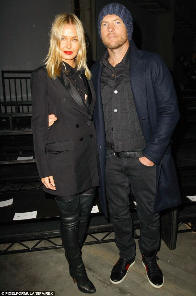 Cute couple: The model pictured at Mercedes Benz Fashion Week with her beau Sam Worthington in New York last month