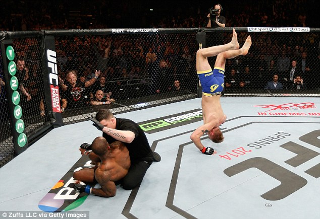 Heads you win: Gustafsson performs a head stand after his TKO victory over Manuwa
