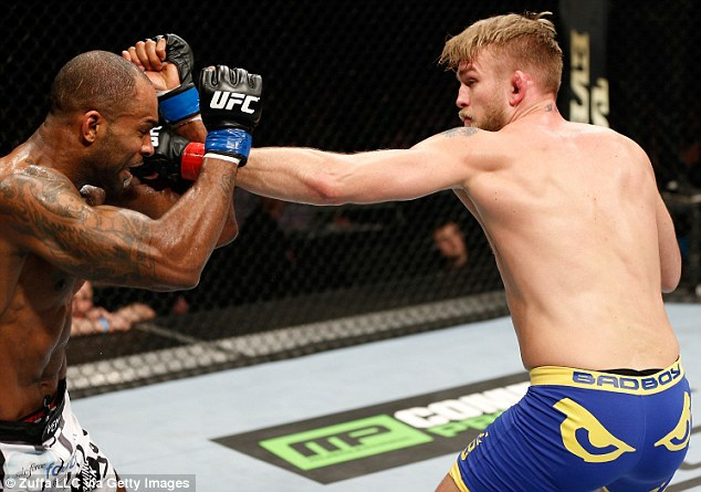 Smack! Alexander Gustaffsson lands a punch on his opponent Jimi Manuwa in their light heavyweight fight at the UFC Fight Night