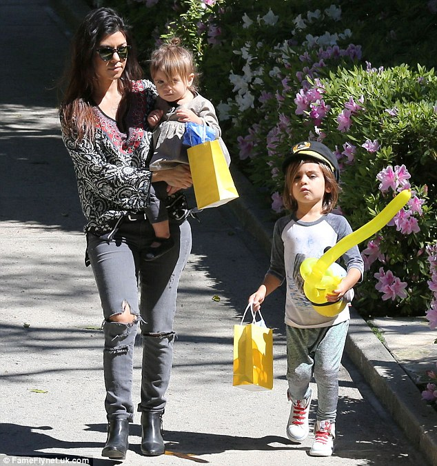 Wedding bells: Kourtney and her longtime beau Scott Scott Disick reportedly have decided to get married