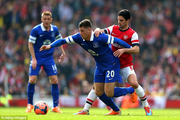 Showing his strength: Ross Barkley holds off Mikel Arteta