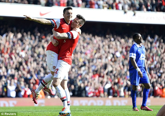 Flying high: Ozil scored the opening goal for Arsenal in their 4-1 win over Everton