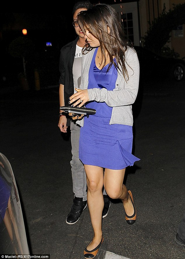 Smart-casual: The actress looked relaxed as she chatted away to her pal in a bright blue minidress