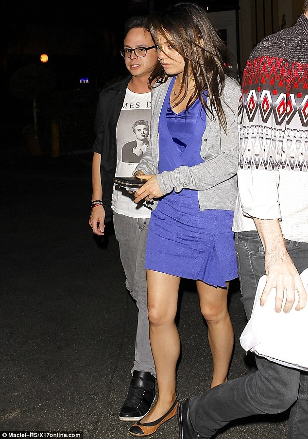 Hard to miss: Meanwhile, Ashton's fiance Mila Kunis flashed her engagement ring during a night out in Hollywood on Saturday evening