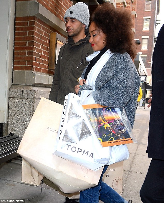 What you bought? Leigh-Anne's fluffy coat was teamed with a monochrome scarf and large hooped earrings