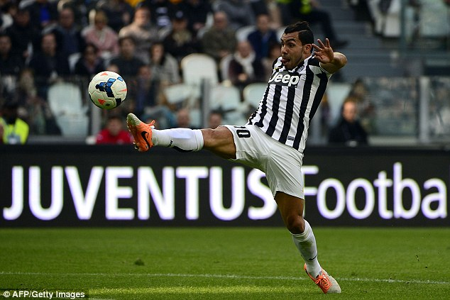 Eyes on the prize: Carlos Tevez stretches to receive a ball as he moves forward