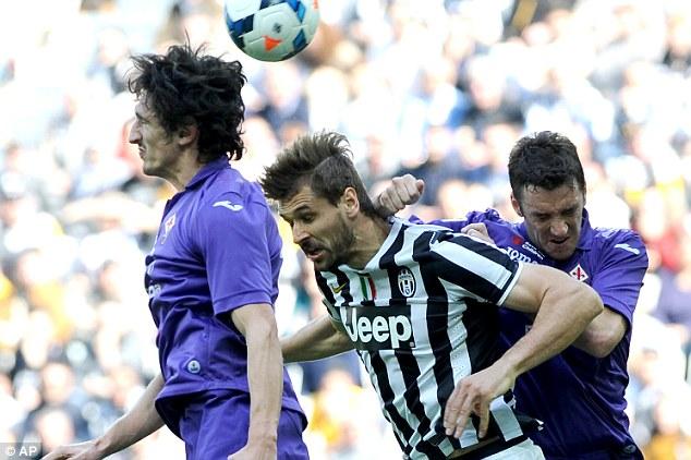 Up high: Fernando Llorente jumps behind former Manchester City defender Stefan Savic