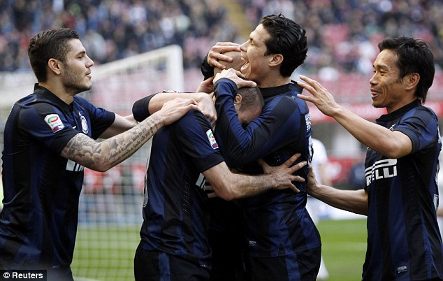 All smiles: The result means Inter are just one point adrift of fourth-placed Fiorentina