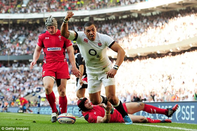 On the money: Luther Burrell raising his arm after diving over to score England's second try