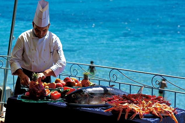 Fine dining: One of the Forte Village Resort's chefs prepares lunch al fresco