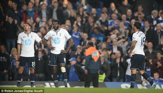 Taking a beating: Ezekiel Fryers , Emmanuel Adebayor and Kyle Naughton look dejected as Spurs lost 4-0 to Chelsea