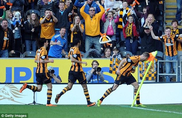 Butt of the joke: Hull midfielder David Meyler shows his sense of humour after scoring on Sunday