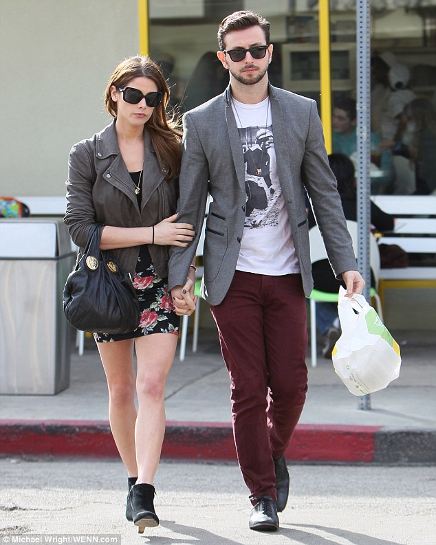 Loved up: Ashley has been dating Liam Hemsworth's best friend, Paul Khoury, since September 2013