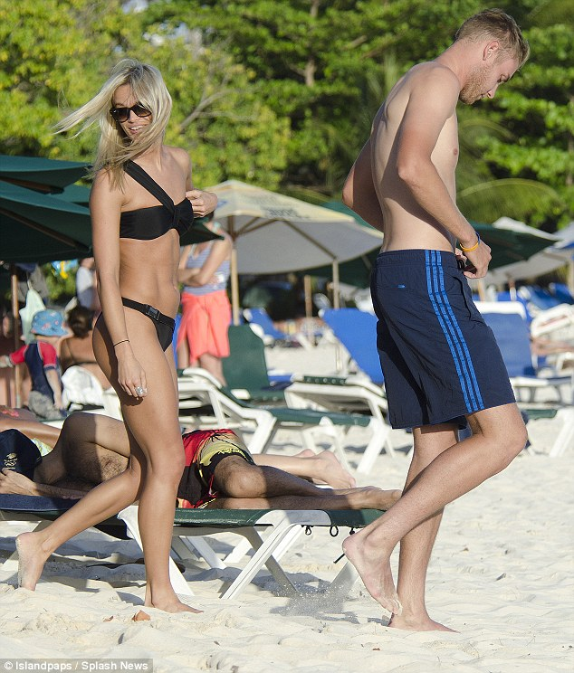 Beach bodies: The star cricketer and his girlfriend boasted enviable bodies