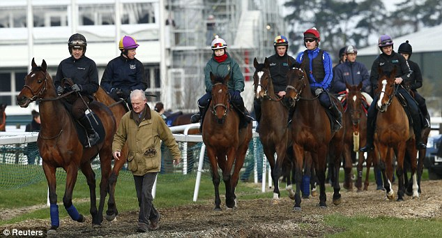 Leading the way: Walsh on Hurricane Fly has a chat with trainer Willie Mullins on Monday morning