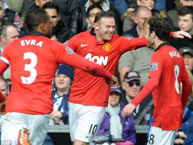 Main man: Van Persie knows he is behind Wayne Rooney (centre) in the pecking order