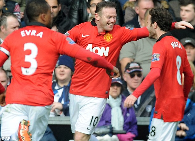 All smiles: Rooney celebrates with Evra (left) and Mata
