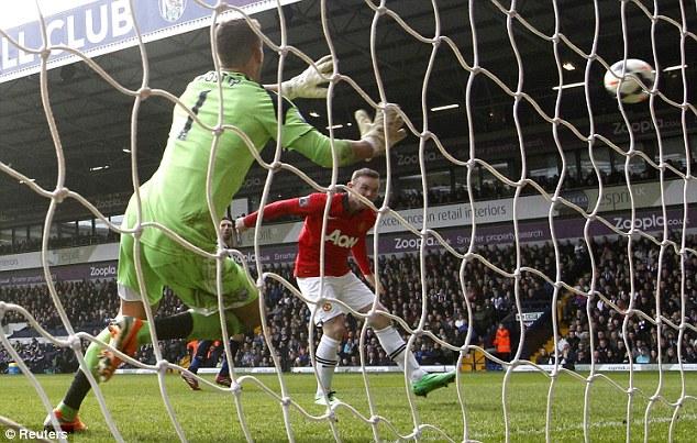 Goalden boy: Wayne Rooney scores at West Brom and (below) celebrates with Patrice Evra (left) and Juan Mata