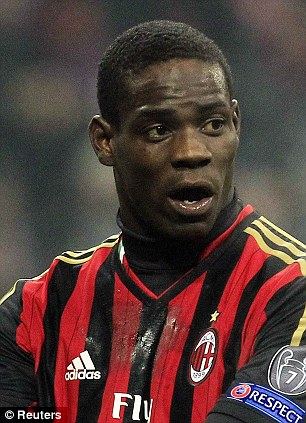 Authorities have revealed one of the two men who used stolen passports to board the missing Malaysian Airlines plane looked like Mario Balotelli (pictured)