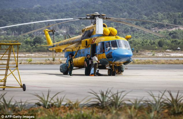 A minister today said rescue helicopters had been scrambled to check a 'yellow object' that rescue teams suspected could have been a life raft from the missing plane, but turned out to be a false alarm