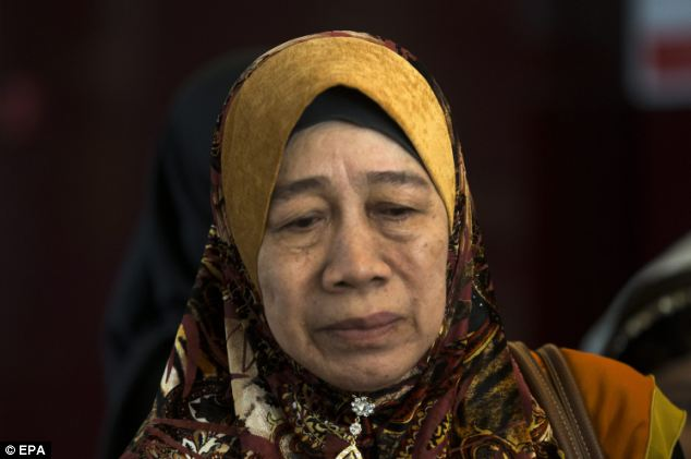 A family member of passengers on the missing Malaysia Airlines flight at a hotel in Putrajaya, Malaysia