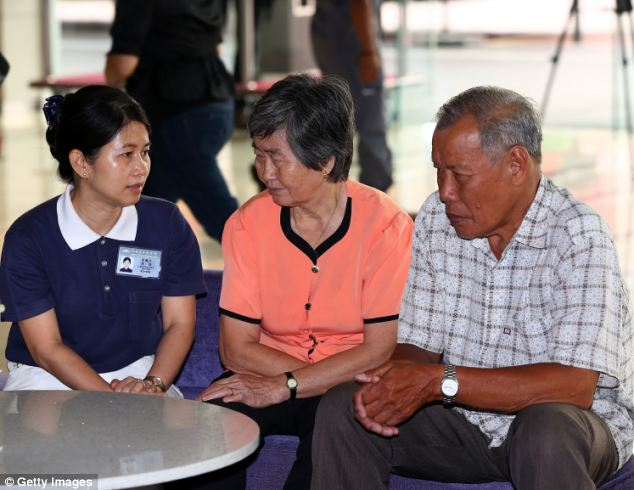 Relatives of a Malaysia Airlines flight MH370 passenger wait for updated information regarding the missing aircraft at a hotel in Putrajaya