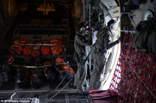 Members of the Republic of Singapore Air Force (RSAF) scan the seas about 140 nautical miles north-east of Kota Baru, Malaysia, for any signs of the missing Malaysia Airlines plane