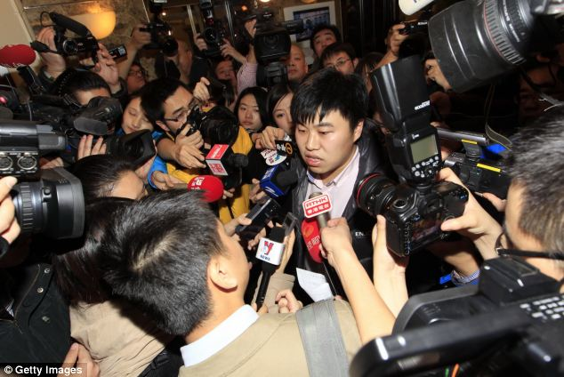 A relative of a passenger on board Malaysia Airlines flight MH370 answers media questions at Lido Hotel in Beijing, China
