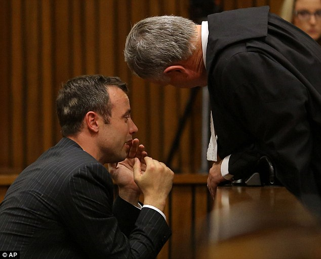 In despair: Oscar Pistorius breaks down in court as he listens to graphic evidence of Reeva Steenkamp's injuries by pathologist who carried out her port-mortem
