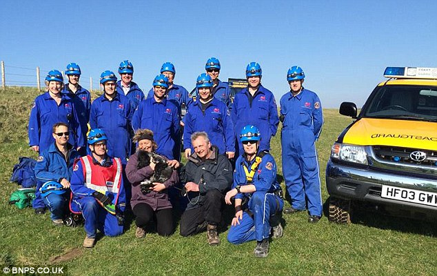Teamwork: Mrs Pipe (centre) is reunited with her pet Marley after Wyke Regis Coastguards rescued him