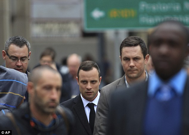 Downcast: Pistorius arriving at Pretoria's high court in the morning