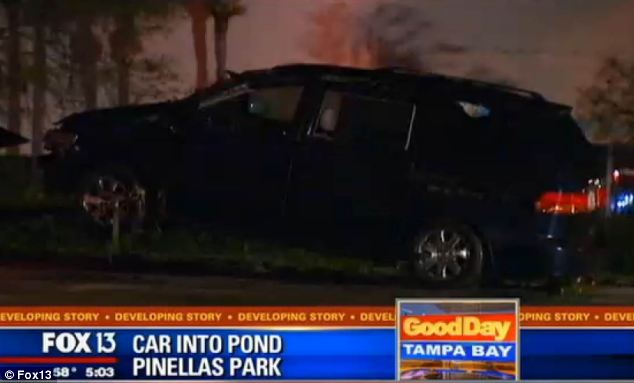 Wreckage: Wolfe's Honda minivan, pictured, was pulled from the pond early on Monday morning