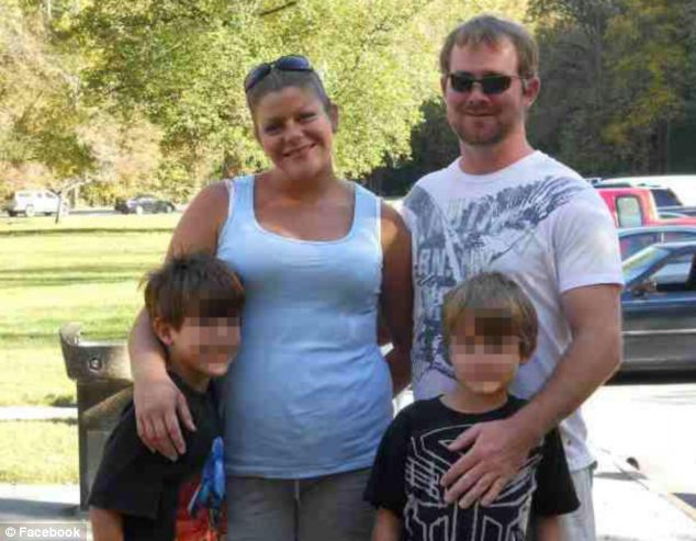 Left behind: Mrs Wolfe, who was studying to be a nurse, is pictured with her husband and two sons
