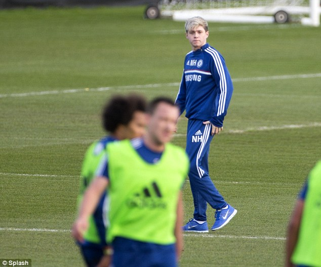 Looking on: Horan watches Chelsea's Willian (left) and John Terry (right) in training