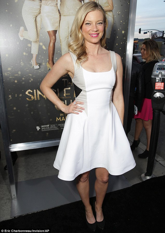 Smart by name: Amy almost stole the show at the premiere in this optical illusion dress