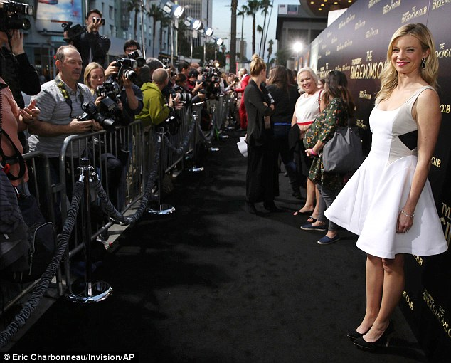 Carpet bagging: The actress seemed to have a great time hogging the attention after she made her entrance