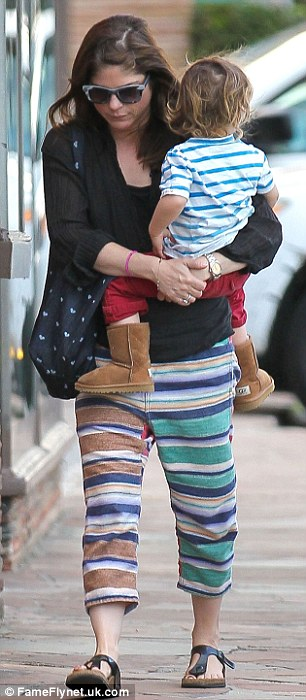 Bonding with her boy: The 41-year-old actress was dressed down in cropped green-and-blue trousers, a black shirt, and matching sandals