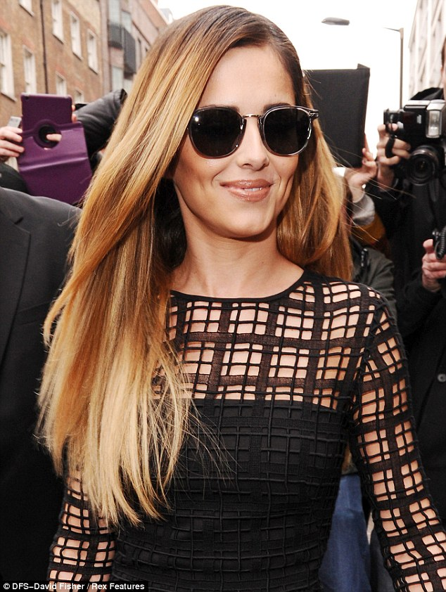 New job, new look: Cheryl Cole unveiled her newly-dyed blonde hair at a press conference after announcing her return to The X Factor