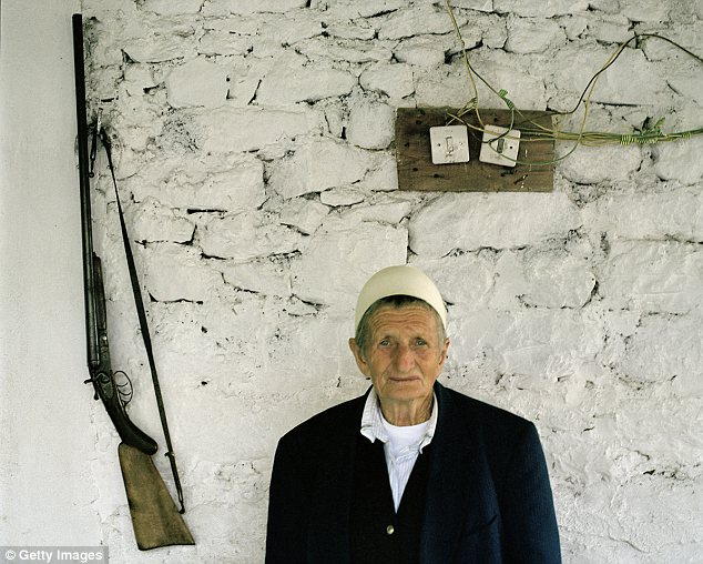 Man of the house: Sokol Zmajli, 80, changed her name from Zhire to the male name Sokol when she was young. She heads the family household consisting of her nephew, his wife, their sons and their wives