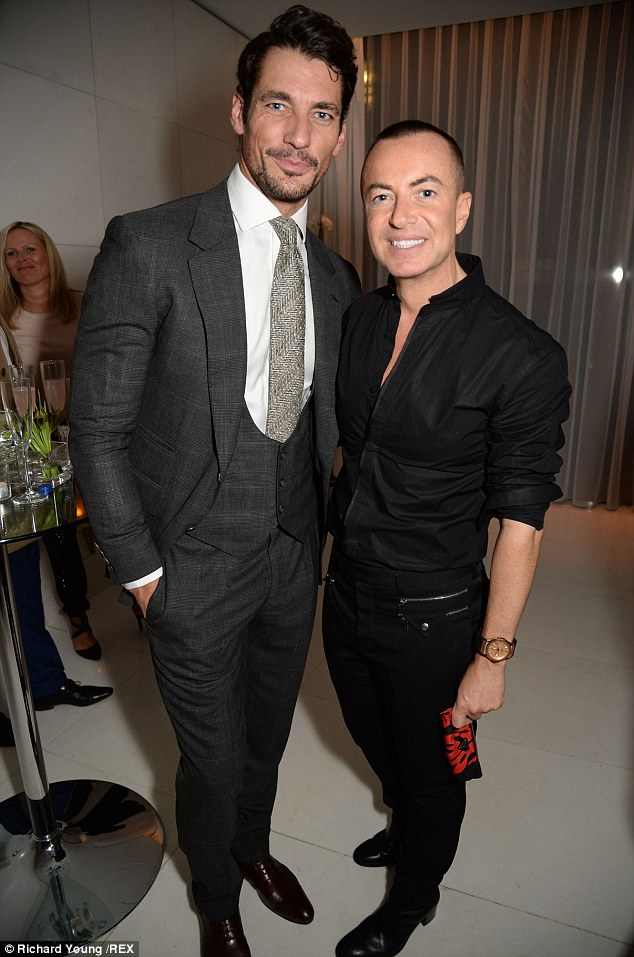 Dapper dudes: David was also seen posing for a snap with designer Julien Mcdonald