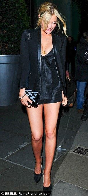 Legs eleven: Laura made her legs look even longer by pairing her outfit with sky-high heels