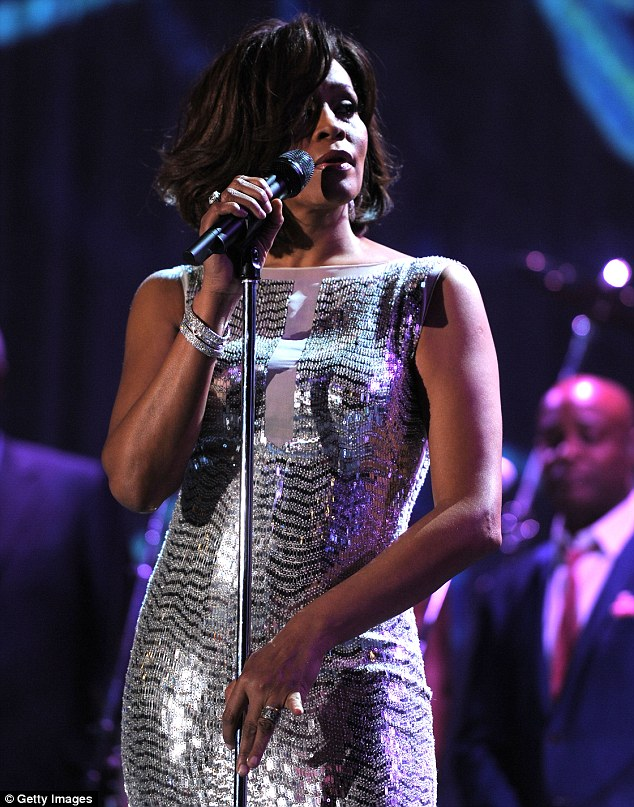 Whitney Houston, pictured here in February 2011, was found floating face down in the bathtub of her room at the Beverly Hilton Hotel