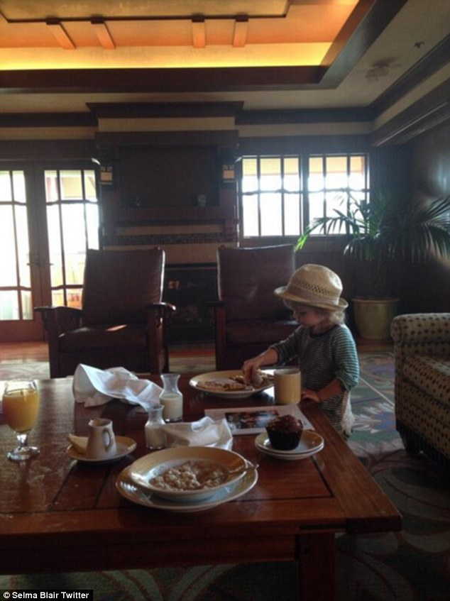 'Casual breakfast in our handsome Disneyland room!' Selma frequently shares candid family pictures of the cherubic youngster with her 53,000 Twitter followers